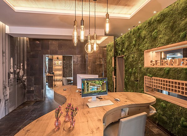 Leather tiles, real moss wall, reception area of the Bavaria Boutique Hotel Munich, photo: Bavaria Boutique Hotel