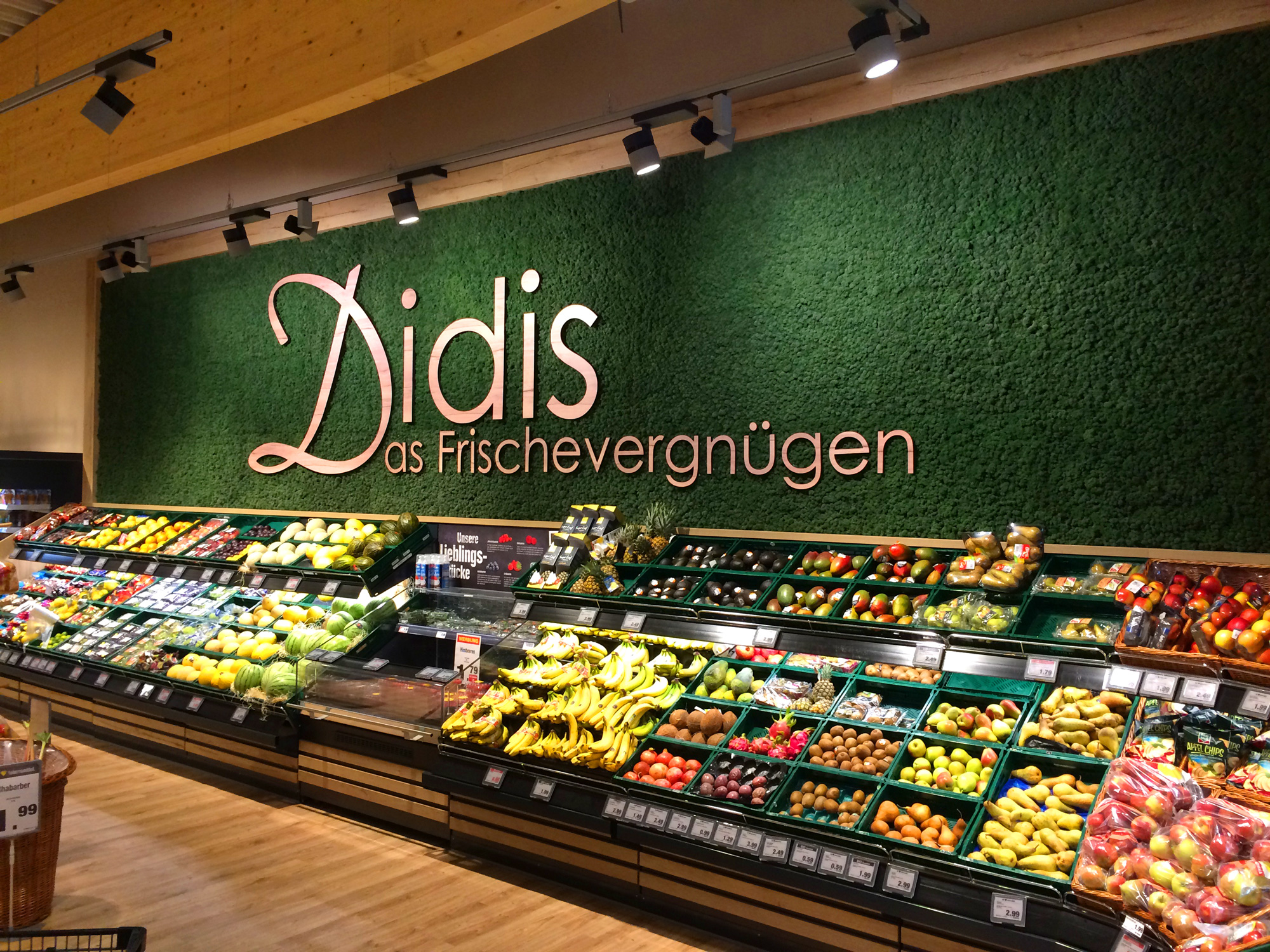 "Evergreen Moss Standard, ""Didis Frischevergnügen"" lettering on background, fruit and vegetables department"