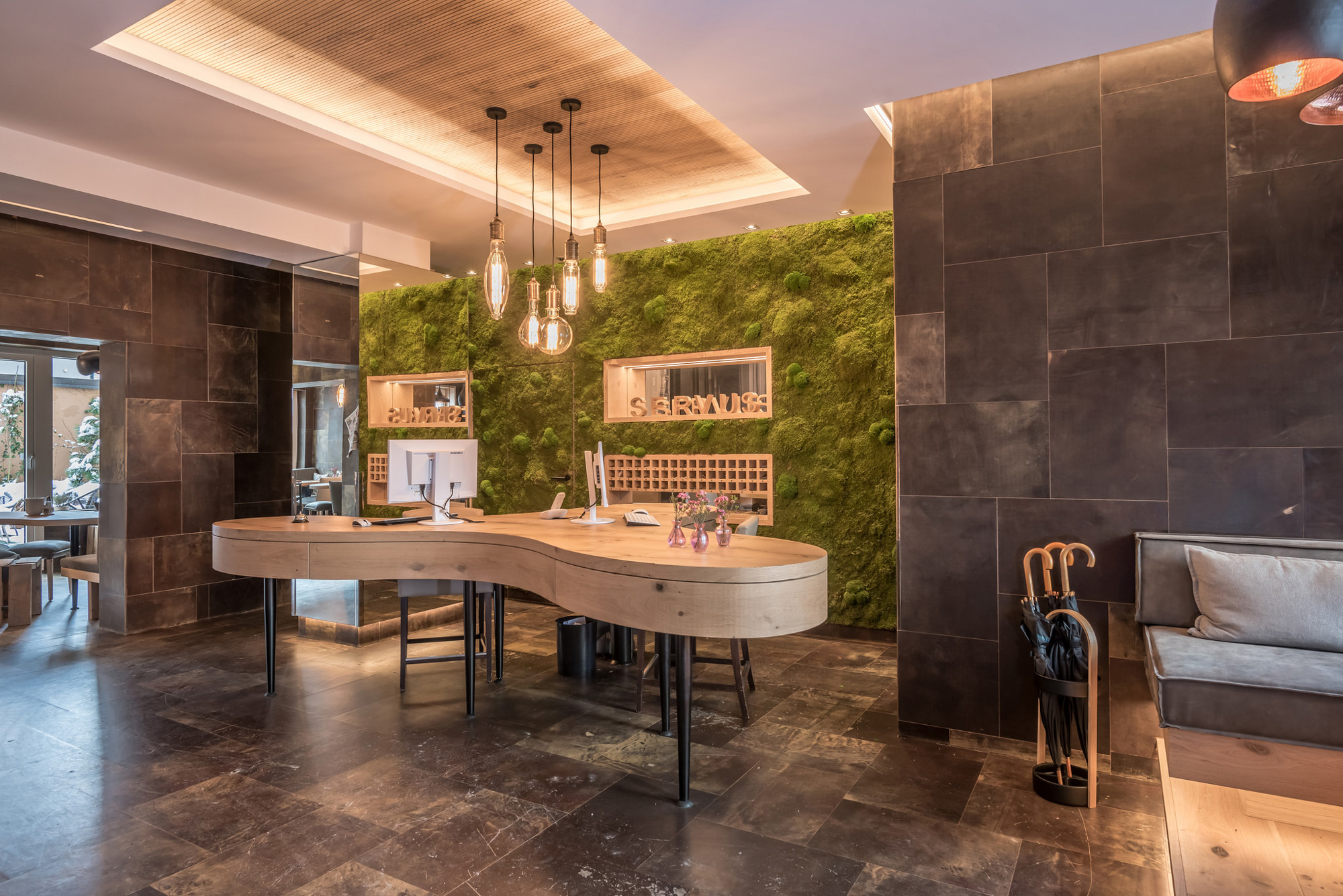 Freund Greenwood moss wall, wall panels with preserved forest moss combined with leather tiles, Boutique Hotel Munich