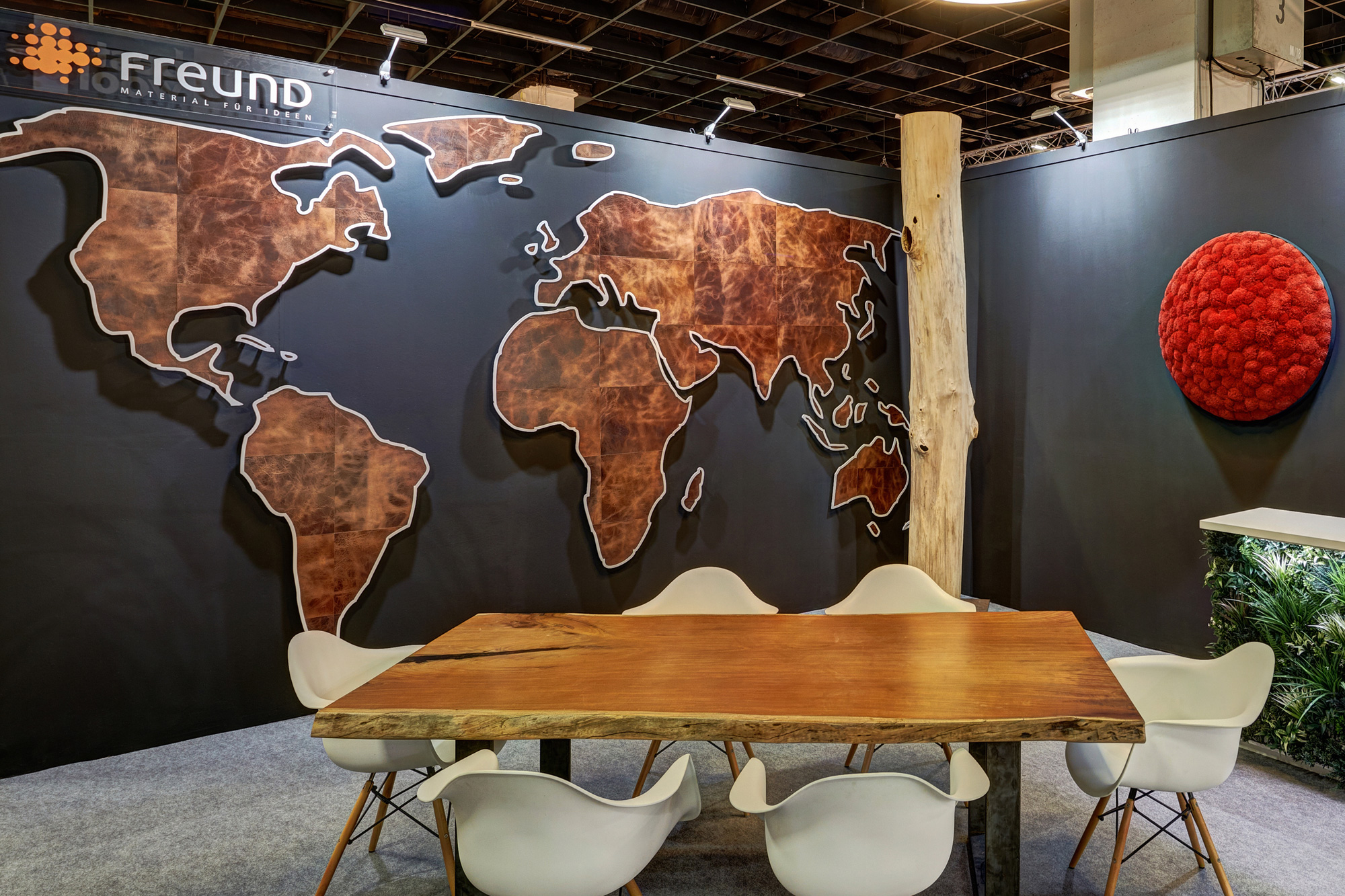 Real leather in custom shape, world map, exhibition installation, imm cologne, Freund GmbH